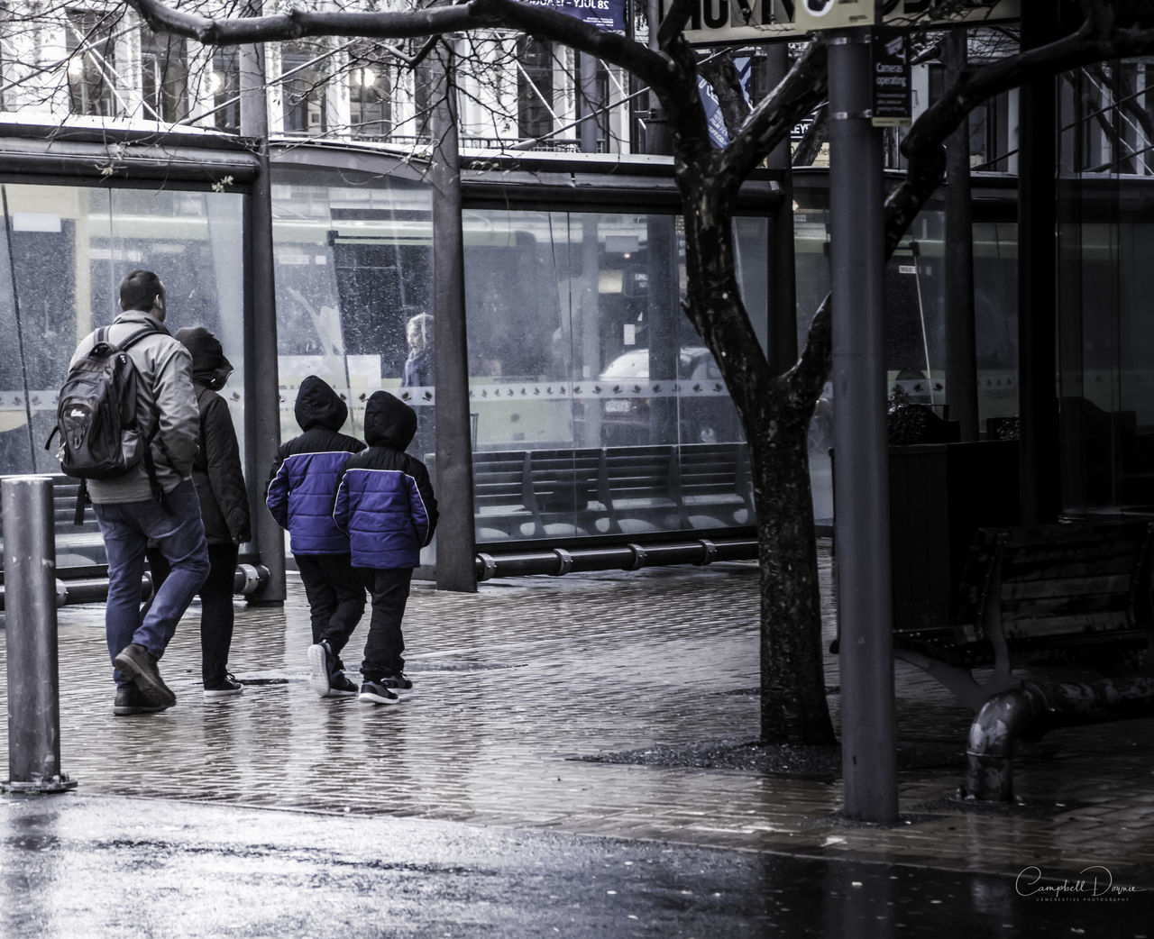 real people, architecture, walking, built structure, rear view, wet, day, building exterior, men, outdoors, full length, women, city, adult, people