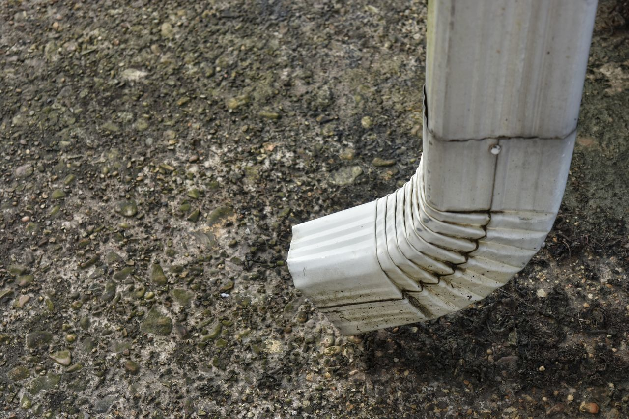 Concrete Sidewalk Gravelly Downspout White Galvanized Curves Bends