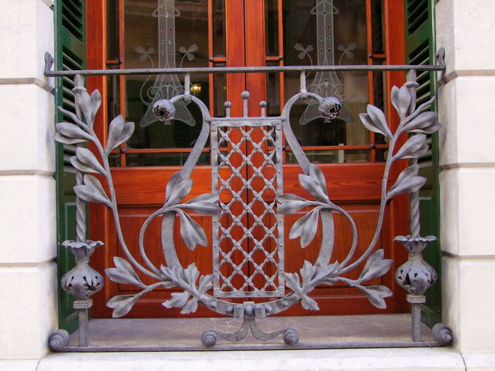 Ornate Window Grill, Gaudi Style Composition Feature Mallorca SPAIN Soller, Mallorca Unusual Achitectural Details Art Art Deco Style Building Exterior Close-up Full Frame Gaudi Style No People Ornate Design Ornate Wrought Iron Outdoor Photography Soller Tourist Destination Travel Destination Window Window Grill Wrought Iron Design