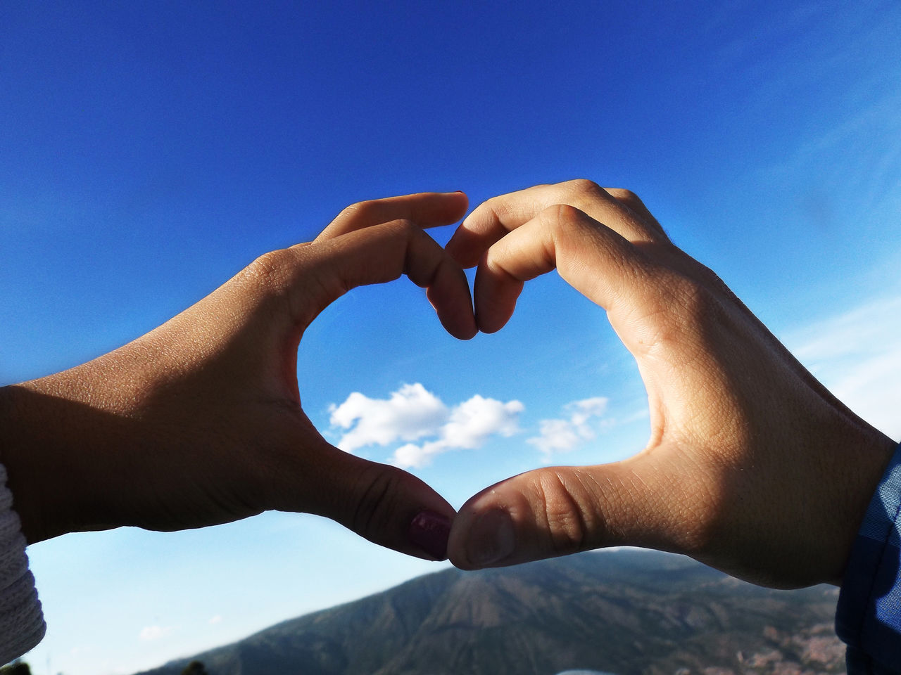 Blue Close-up Day Forming Heart Shape Human Body Part Human Finger Human Hand Love Nature Outdoors Real People Shape Sky Togetherness Two People