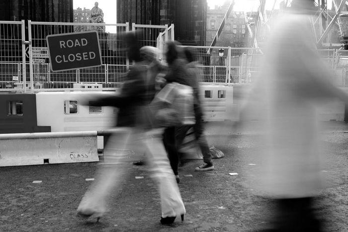 B&w Blackandwhite Blur Blurred Motion Casual Clothing City City Life Edinburgh Full Length Men Motion Outdoors Person Road Road Closed Sign Street Streetphotography Transportation Walking