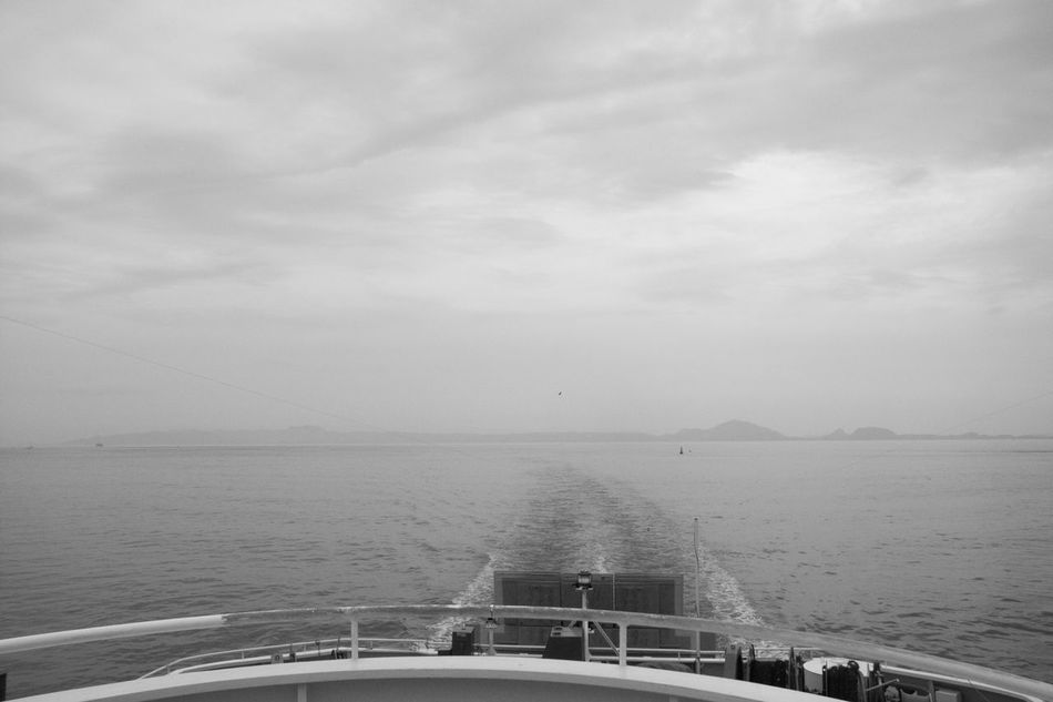 calm sea Ferry Views Monochrome Scenics Sea Wake Water Clouds Sky Tranquility Black And White Nature Horizon Over Water Tranquil Scene Beauty In Nature Bird GR DIGITAL Ⅱ Ferry Calm Sea Day Japan