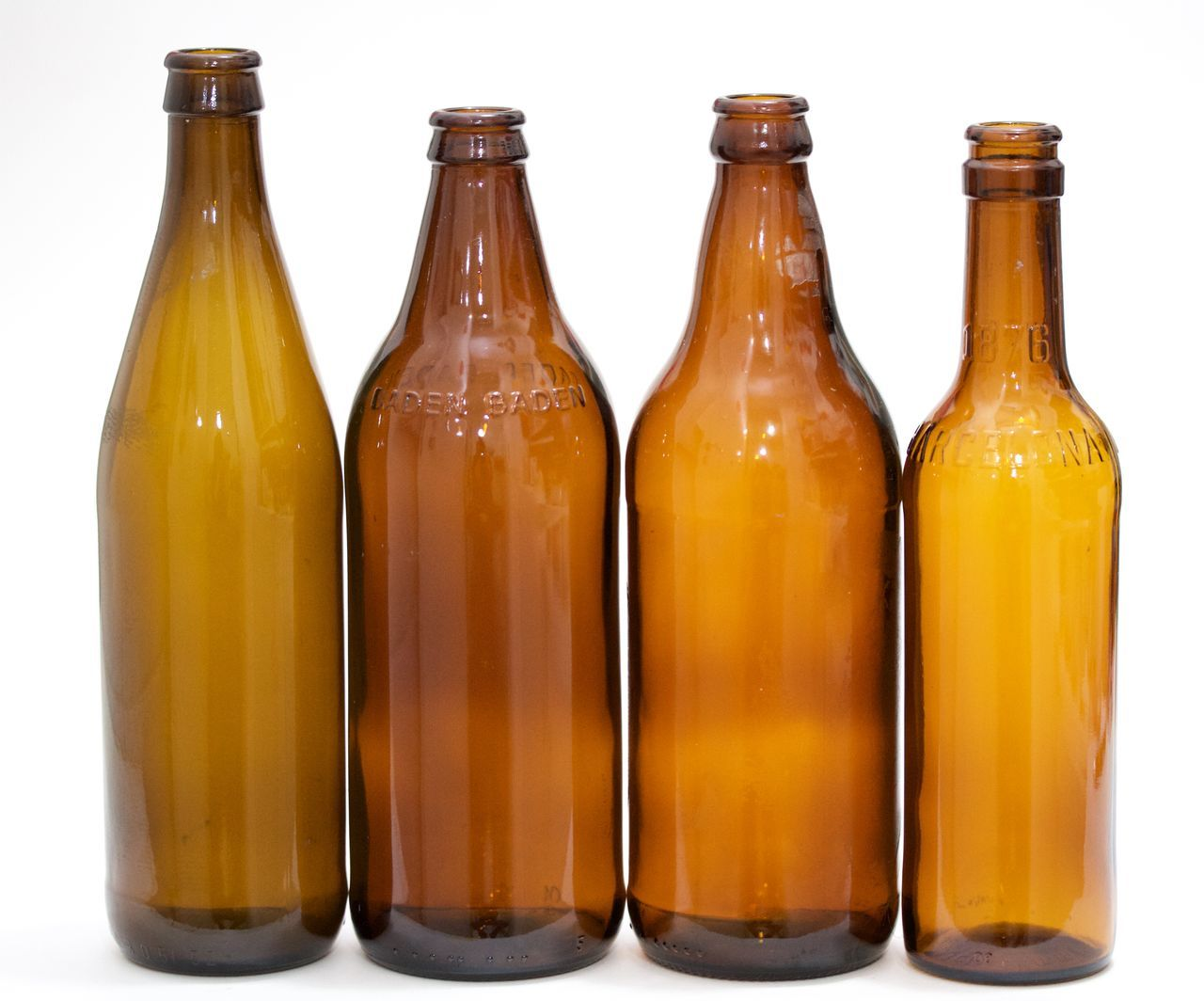 four brown bottles on white background Alcohol Beer Bottle Brown Bottles Cultures Food Food And Drink Glass - Material No People