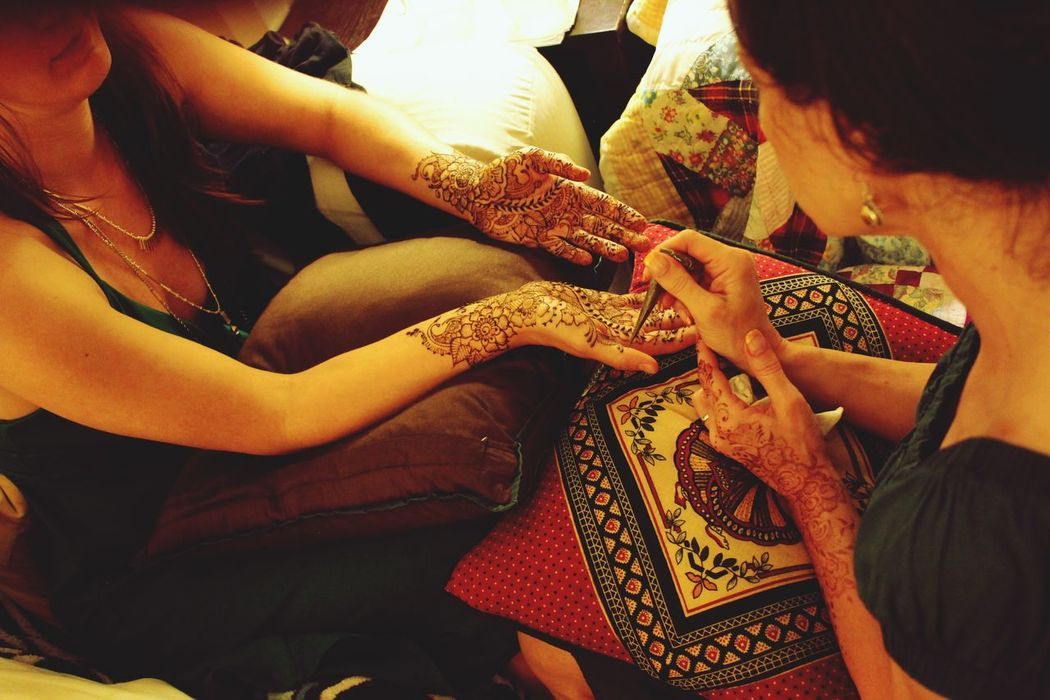 Human Hand Real People Togetherness Women Sitting Indoors  Human Body Part Men Lifestyles Leisure Activity Two People Friendship Bonding Day Young Women Young Adult Bride Close-up Adult Henna Art High Angle View Henna Tattoo MehndiDesign Design Pattern