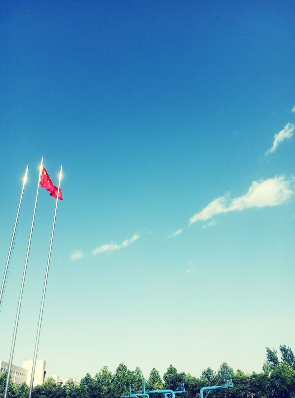 flag, patriotism, low angle view, sky, cloud - sky, day, blue, no people, outdoors, pride, nature, beauty in nature