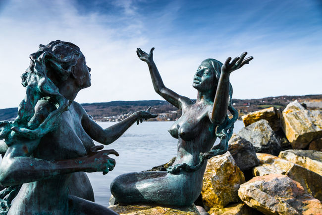 Animal Representation Art Art And Craft Carving - Craft Product Cloud - Sky Craft Creativity Day De Trehavfruer Drøbak Famous Place Human Representation Low Angle View Mermaids Rock - Object Sculpture Sky Statue Stone Material Three Travel Destinations Water