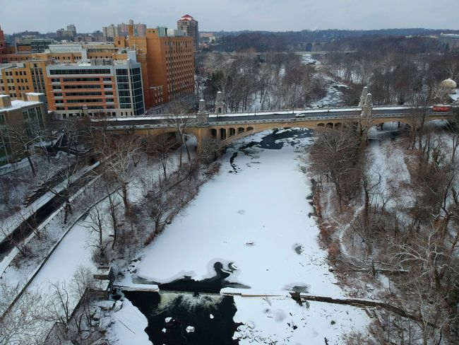 Wilmington, Delaware, U.S.A - December 30, 2017 - Aerial view of half-frozen Brandywine River and the city of Wilmington after a snowy day Snow Wilmington Delaware River Frozen Ice Water No People Day Outdoors Bridge - Man Made Structure Tree City