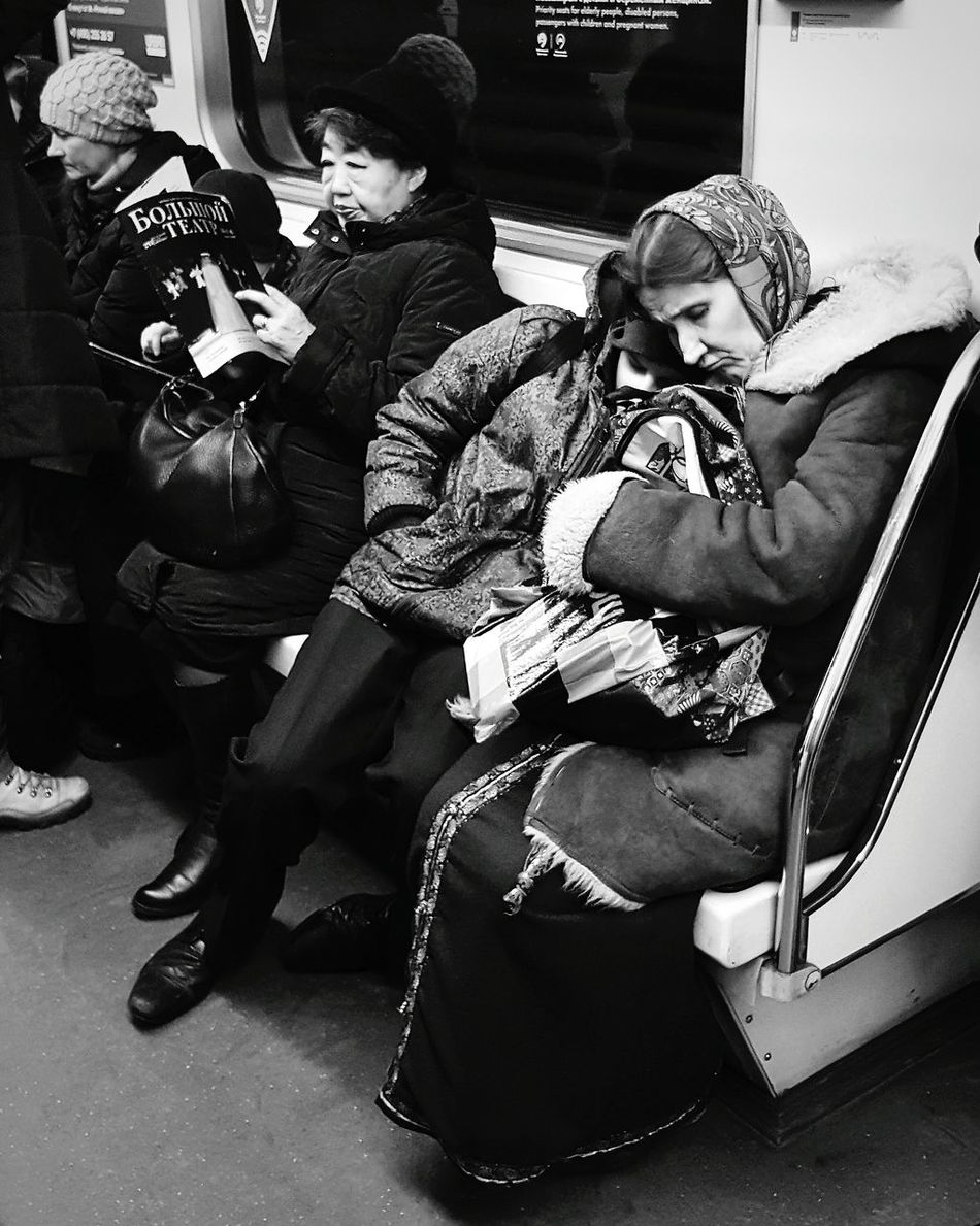 Transportation Public Transportation Passenger Mode Of Transport Adult People Sitting Real People Subway Train Public Transportation Metro Moskau Moscow Metro Indoors  Russia Close-up Subway Metro Station Poverty Lives. Poverty Mother And Son Child Black And White Photography Blackandwhite Photography City