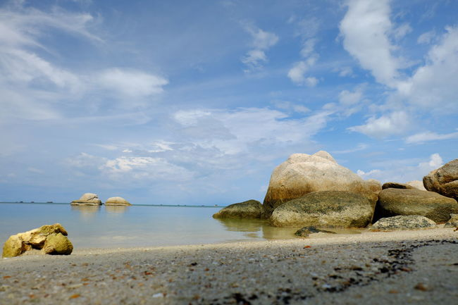 Beach Beauty In Nature Cloud Cloud - Sky Nature Rock - Object Rock Formation Sand Scenics Sea Shore Sky Stone - Object Tourism Tranquil Scene Tranquility Travel Destinations Water