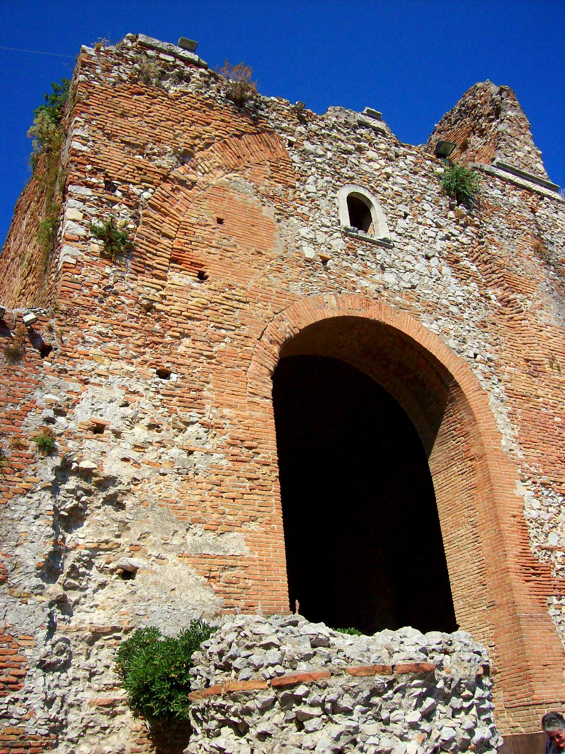 Arch Architecture Blue Building Exterior Built Structure Clear Sky Damaged Day Entrance Exterior Fortified Wall History Low Angle View Medieval Old Ruin Outdoors Ruined Sicily Stone Wall Sunny Taormina And Etna Teatro Antico Di Taormina The Past Tower Wall