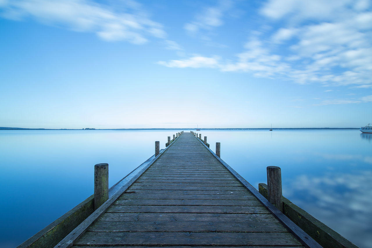 Blue silence✨The sound of silence by. Simon and Garfunkel✨ Waterfront Sailing Walkway Horizon Over Water Cloudy Pier Eyeem Market From My Point Of View EyeEm Gallery Cloud - Sky Calm Blue Sky Sea Tranquility Tranquil Scene Reflection Water Cloud Loneliness Solitude capturing motion Beauty In Nature Wood Paneling Steinhuder Meer light and reflection Long Goodbye The Great Outdoors - 2017 EyeEm Awards BYOPaper! Sommergefühle EyeEm Selects Let's Go. Together. Breathing Space Investing In Quality Of Life EyeEmNewHere The Week On EyeEm Your Ticket To Europe Mix Yourself A Good Time Been There. Discover Berlin Done That. Lost In The Landscape Connected By Travel Second Acts Perspectives On Nature Rethink Things Postcode Postcards Be. Ready. Step It Up One Step Forward EyeEm Ready   AI Now