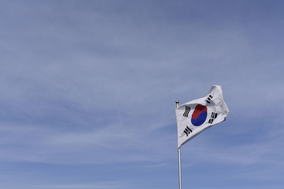 Cloud - Sky Day Flag Guidance Korea Low Angle View Nature No People Outdoors Road Sign Sky