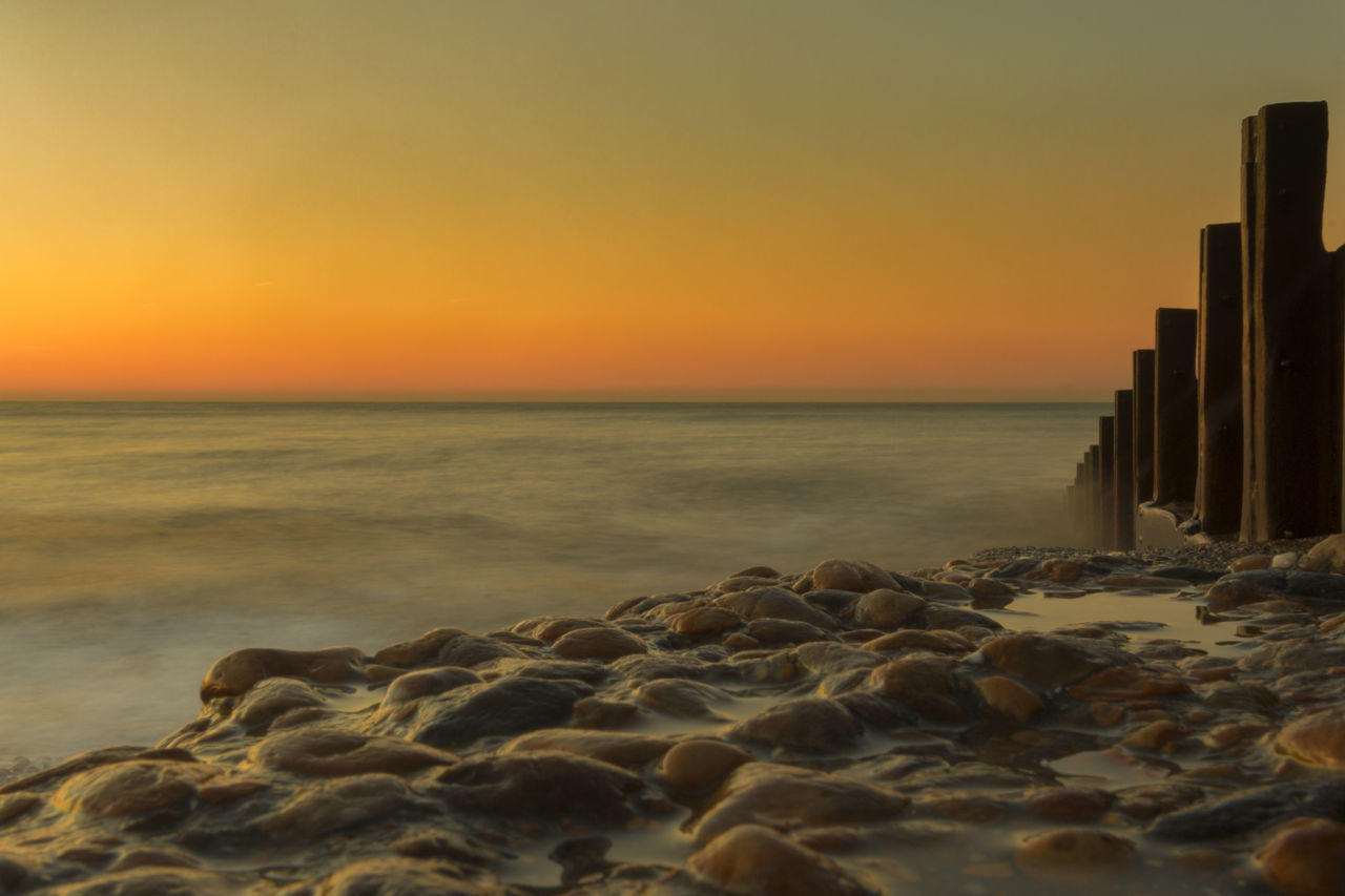 Sunrise at Hastings beach with groyne Beach Beauty In Nature Coastline Day Horizon Over Water Nature No People Outdoors Pebble Pebble Beach Scenics Sea Sky Sunset Tranquil Scene Tranquility Water