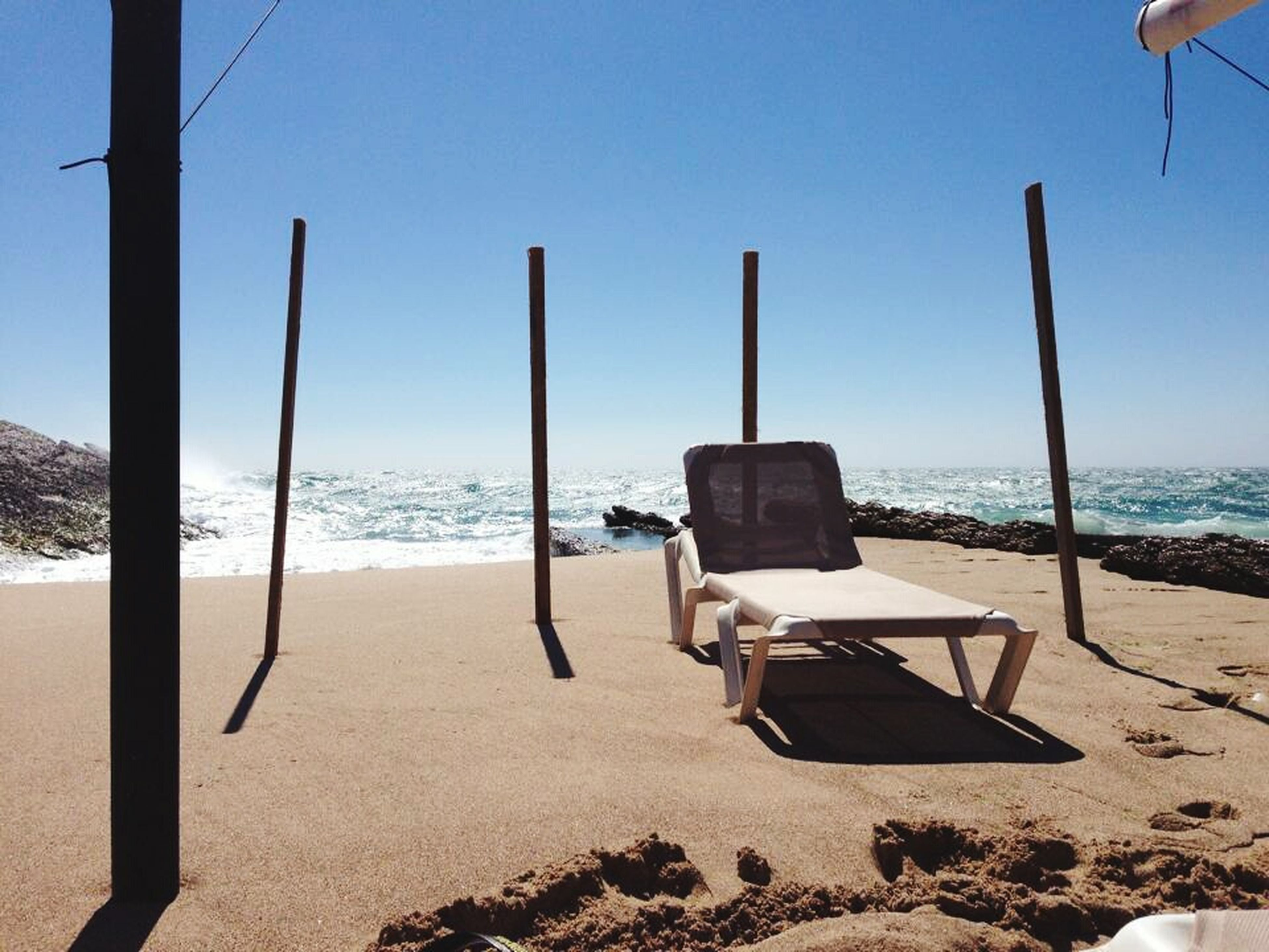 sea, beach, sand, horizon over water, water, clear sky, shore, absence, sunlight, sky, shadow, tranquil scene, tranquility, empty, day, chair, outdoors, scenics, nature, blue