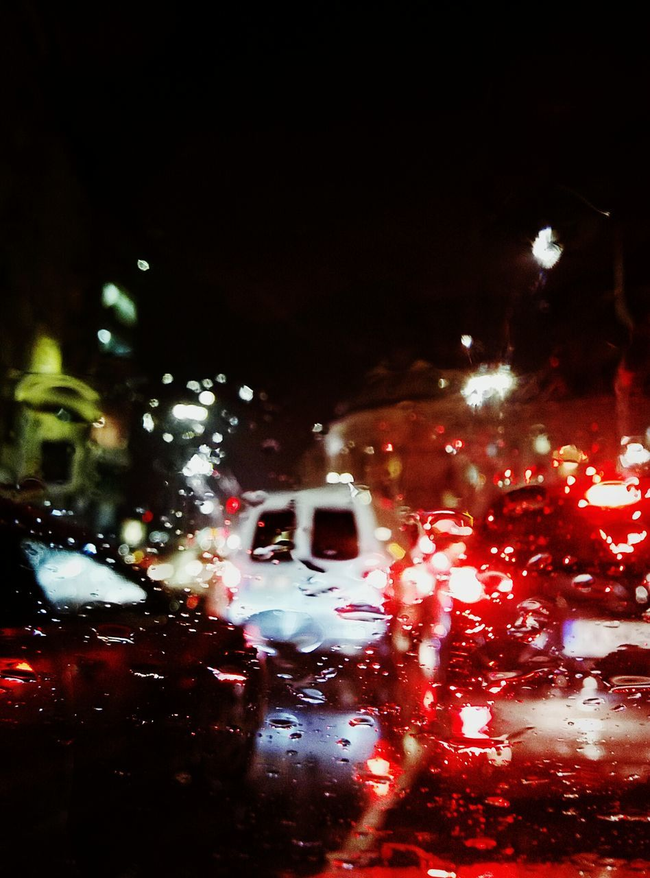 car, land vehicle, transportation, illuminated, mode of transport, night, car interior, vehicle interior, windshield, road, street, wet, no people, window, travel, car point of view, raindrop, red, outdoors, close-up, nature, sky