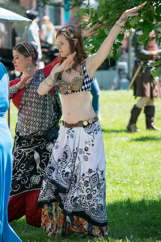 Arts Culture And Entertainment Belly Dance Belly Dancer Belly Dancing Costume Dance Day Fairgrounds Fashion Festival Focus On Foreground Happiness Incidental People Leisure Activity Lifestyles Outdoors People Preformance Real People Skirt Young Adult Young Women