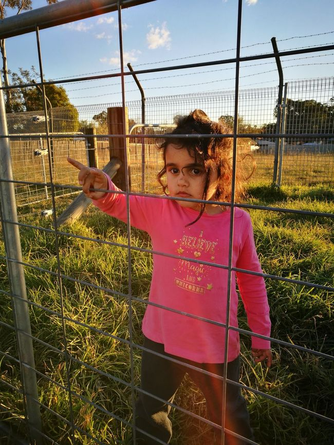 Childhood Front View Casual Clothing Farm Life Afternoon Sky Sunset Sky Fences & Beyond Looking Away Behind The Gate
