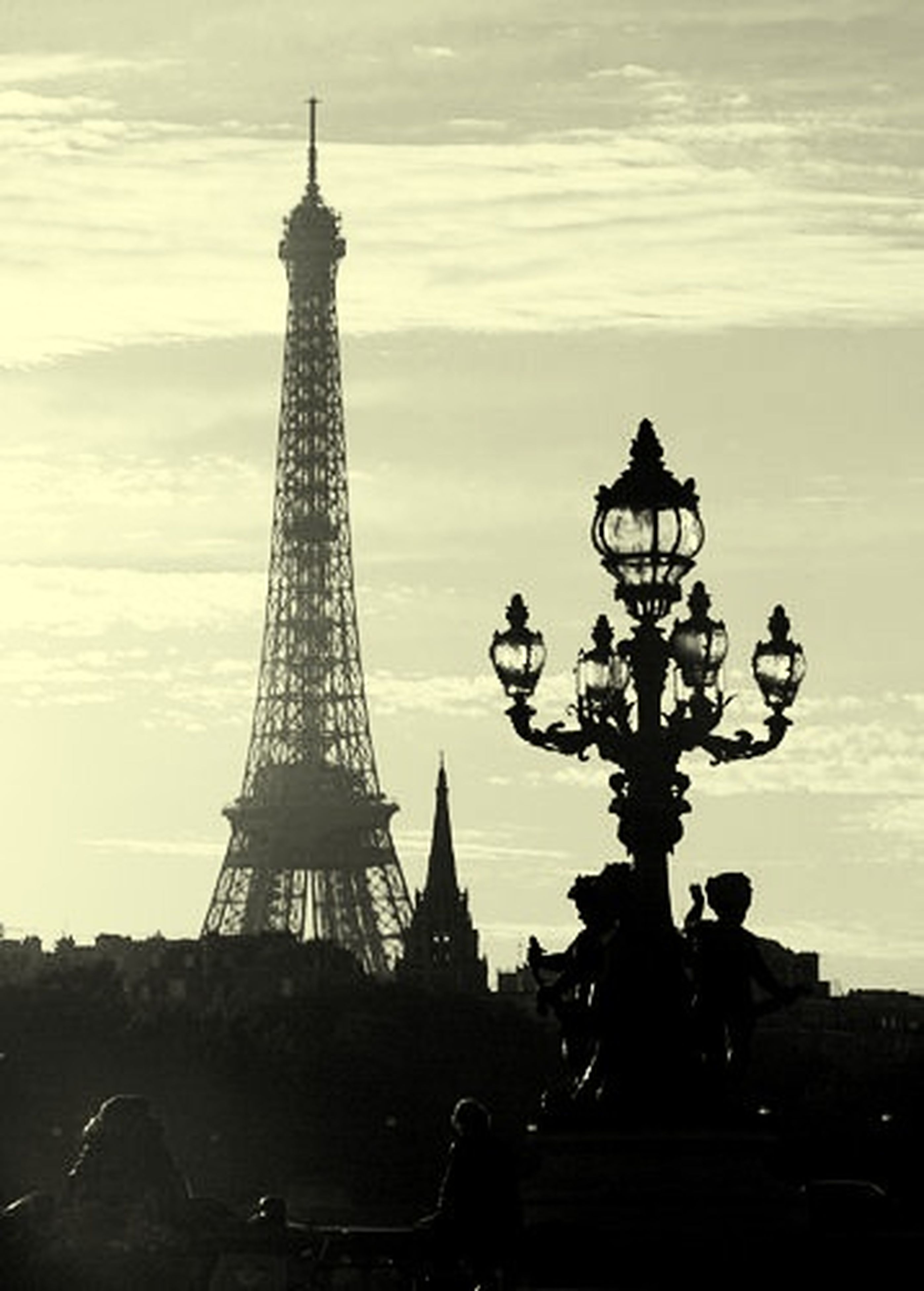 architecture, built structure, famous place, international landmark, tall - high, tower, tourism, travel destinations, eiffel tower, building exterior, capital cities, sky, travel, city, communications tower, culture, sunset, spire, silhouette, low angle view
