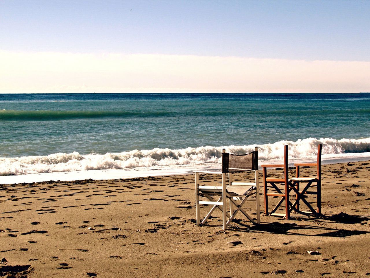 Two chairs overlooking sea