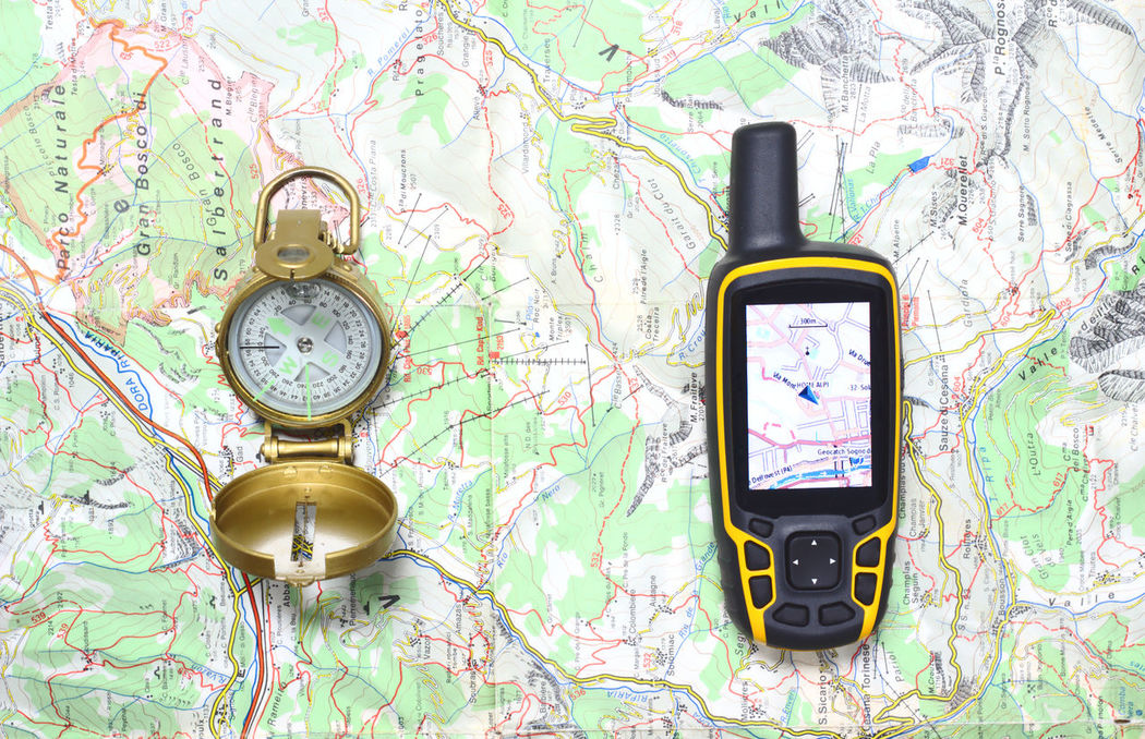 Compass and GPS receiver on a map. Close-up Compass Exploration Exploring Geocaching GPS Gps Receiver Guide Hiking Latitude Map MapWorld Mountain Navigation Orienteering Outdoors Position Route Sport Survival Tourism Travel Traveling Trekking Waypoint