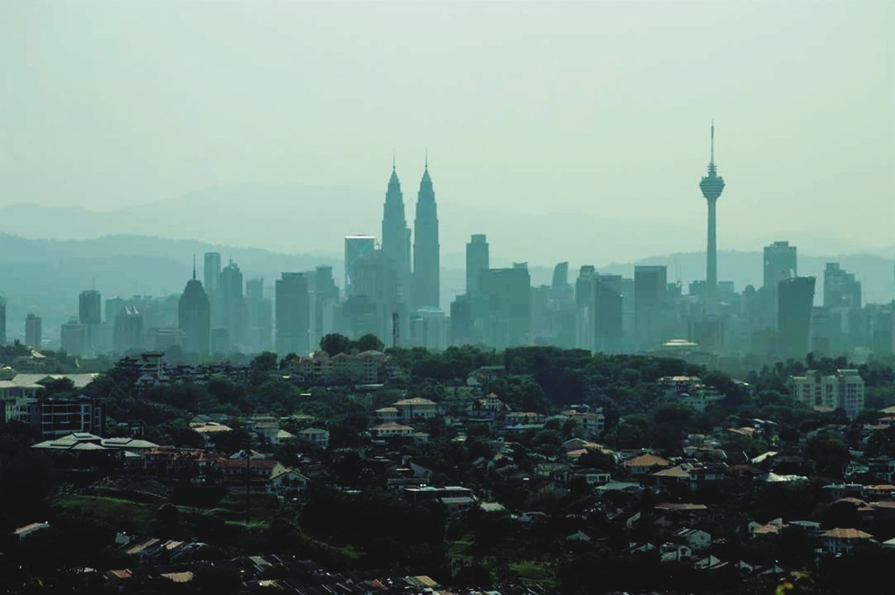 architecture, tall - high, tower, building exterior, built structure, skyscraper, cityscape, travel destinations, city, tourism, outdoors, modern, no people, tall, urban skyline, sky, day, fog, nature