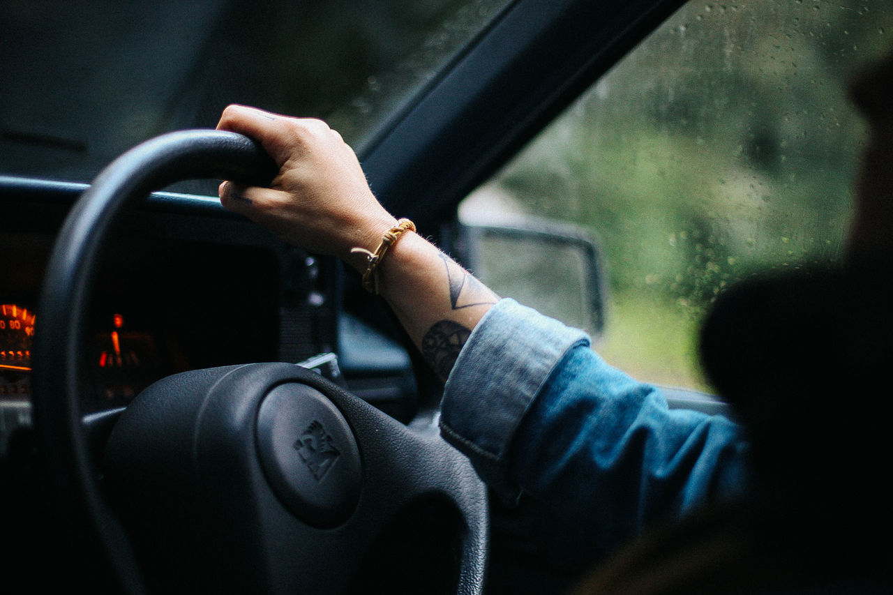 Car Car Interior Close-up Dashboard Drive Driving Driving Hand Hands Human Hand Journey Land Vehicle Mode Of Transport One Person Outdoors Rain Rainy Rainy Days Real People Speedometer Steering Wheel Transportation Travel Vehicle Interior Windscreen