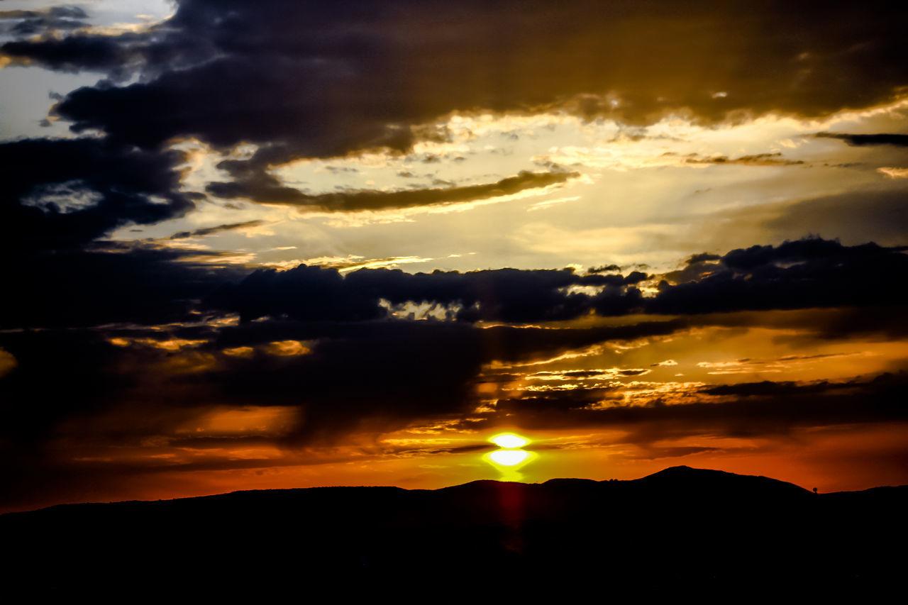 sunset, silhouette, sky, cloud - sky, scenics, tranquil scene, nature, beauty in nature, sun, orange color, tranquility, dramatic sky, majestic, idyllic, no people, outdoors, mountain, landscape