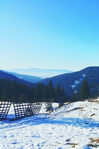 Snow Mountain Winter Cold Temperature Scenics Beauty In Nature Mountain Range No People Landscape Nature Blue Outdoors Tree Day Lake Tranquility Rural Scene Forest Clear Sky Water Photo Growth Blue Sky Oil Pump Tree