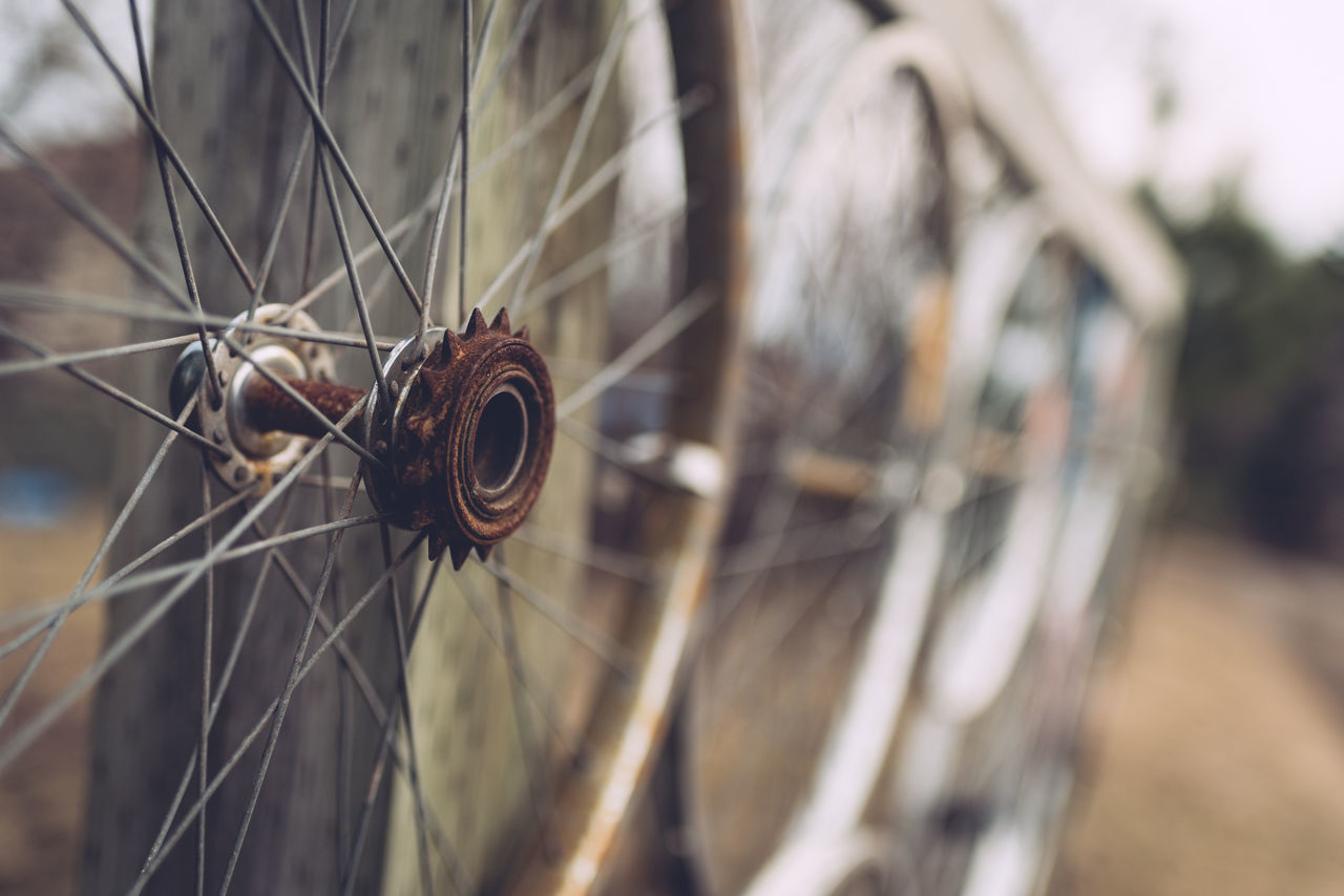 Angled View Close-up Day Fence Mode Of Transport No People Outdoors Rusty Selective Focus Spoke Tire Transportation Wheel