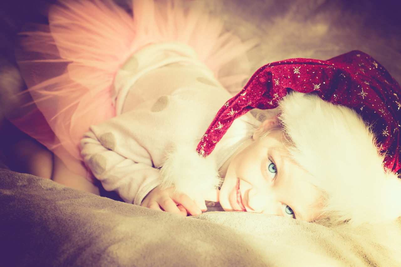Ballerina Beauty Bedroom Blue Eyes Child Christ Christmas Christmas Tree Girl Hat Indoors  Lying Down One Person Pillow Playful Portrait Relaxation Santa