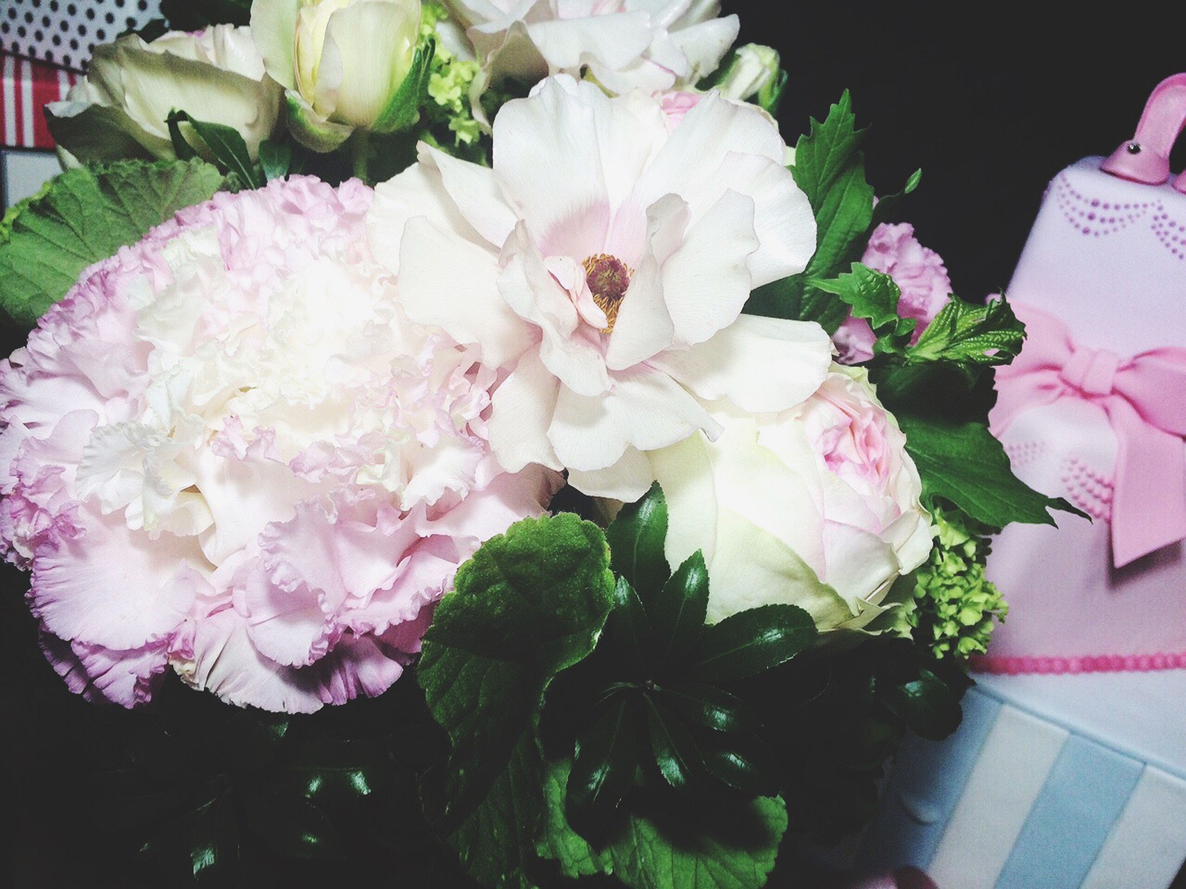 flower, freshness, petal, fragility, flower head, beauty in nature, indoors, bunch of flowers, bouquet, pink color, high angle view, growth, close-up, nature, plant, blooming, leaf, flower arrangement, rose - flower, no people