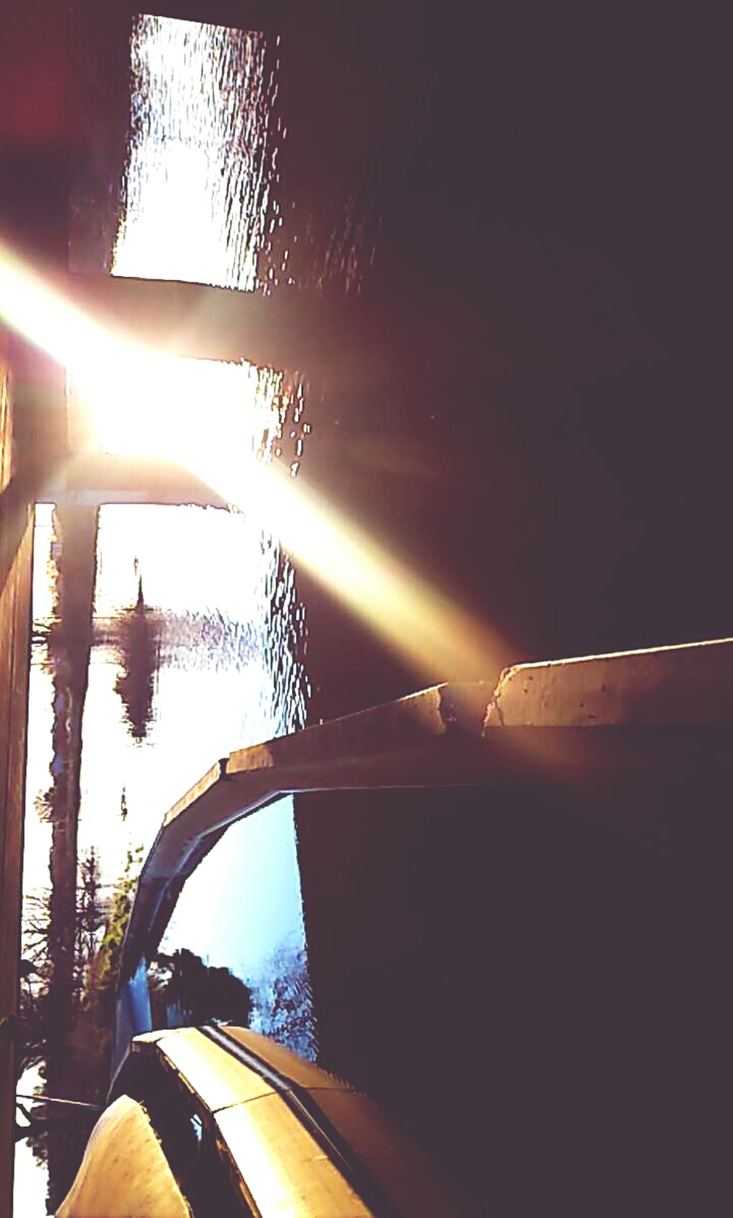 transportation, sun, low angle view, mode of transport, sunlight, sunbeam, lens flare, silhouette, one person, sky, part of, car, sunset, cropped, land vehicle, clear sky, outdoors, street light, connection, on the move