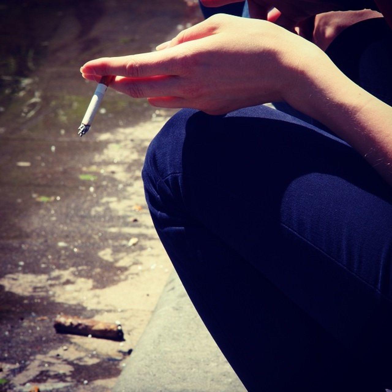 Human Hand Holding Cigarette