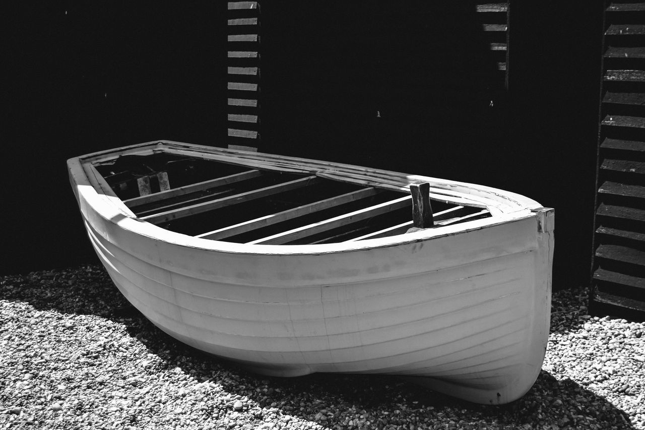 Black & White Black And White Boat Boat Sitting On Gravel Close-up Day Fishermen's Museum Light And Shadow Monochrome Net Shops No People Old Boat Outdoors Rowing Boat Sunlight Timber Frame Transportation