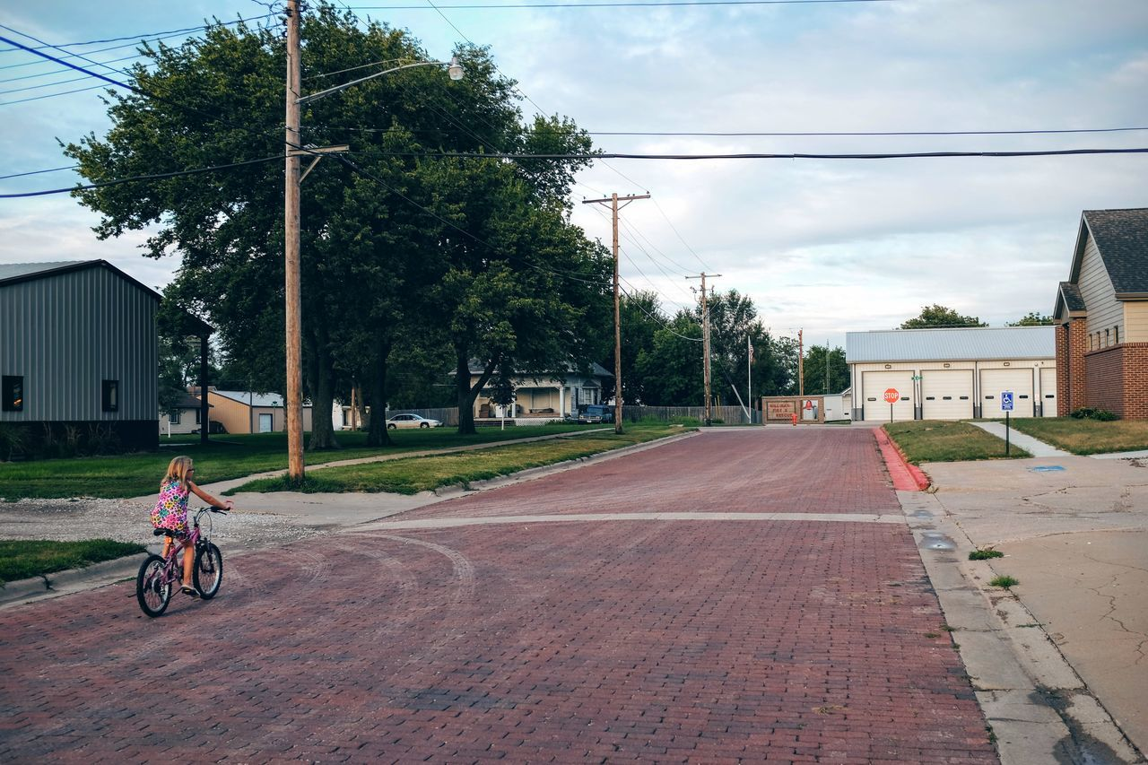 Photo essay, a day in the life. August 24, 2016 Milligan Nebraska 35mm Camera A Day In The Life Bicycle Brick Lane Brick Road Camera Work Casual Clothing Composition Everyday Lives Eye For Photography EyeEm Gallery Eyeemphoto FujiX100S Kids Mode Of Transport Outdoors Person Photo Essay Power Line  Road Small Town Small Town Stories Small Town USA Storytelling Streetphotography
