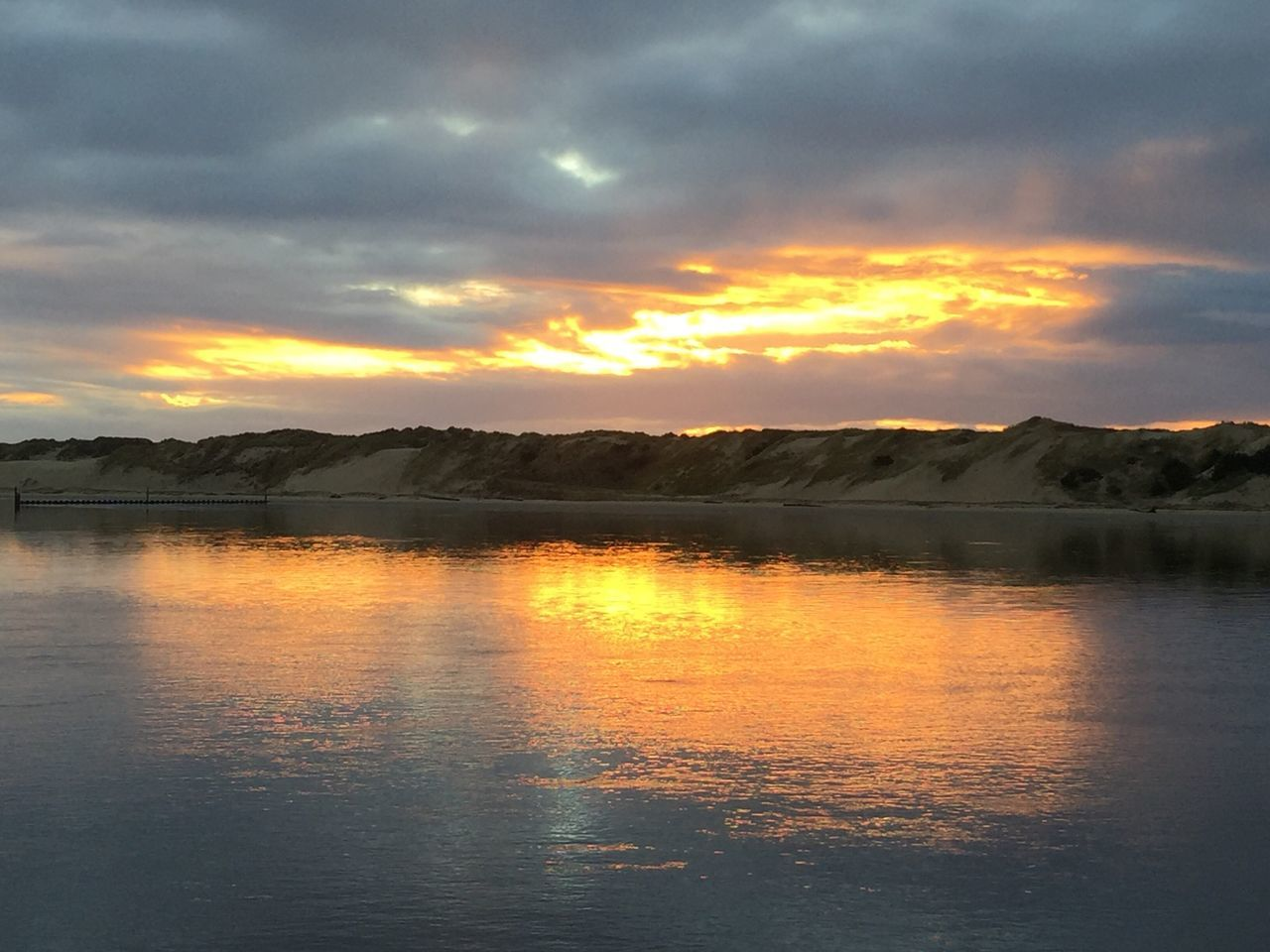 Sunset Beauty In Nature Reflection Water Tranquil Scene Idyllic Sky Tranquility Scenics No People Waterfront Dramatic Sky Vibrant Color : Siuslaw River, Oregon Coast