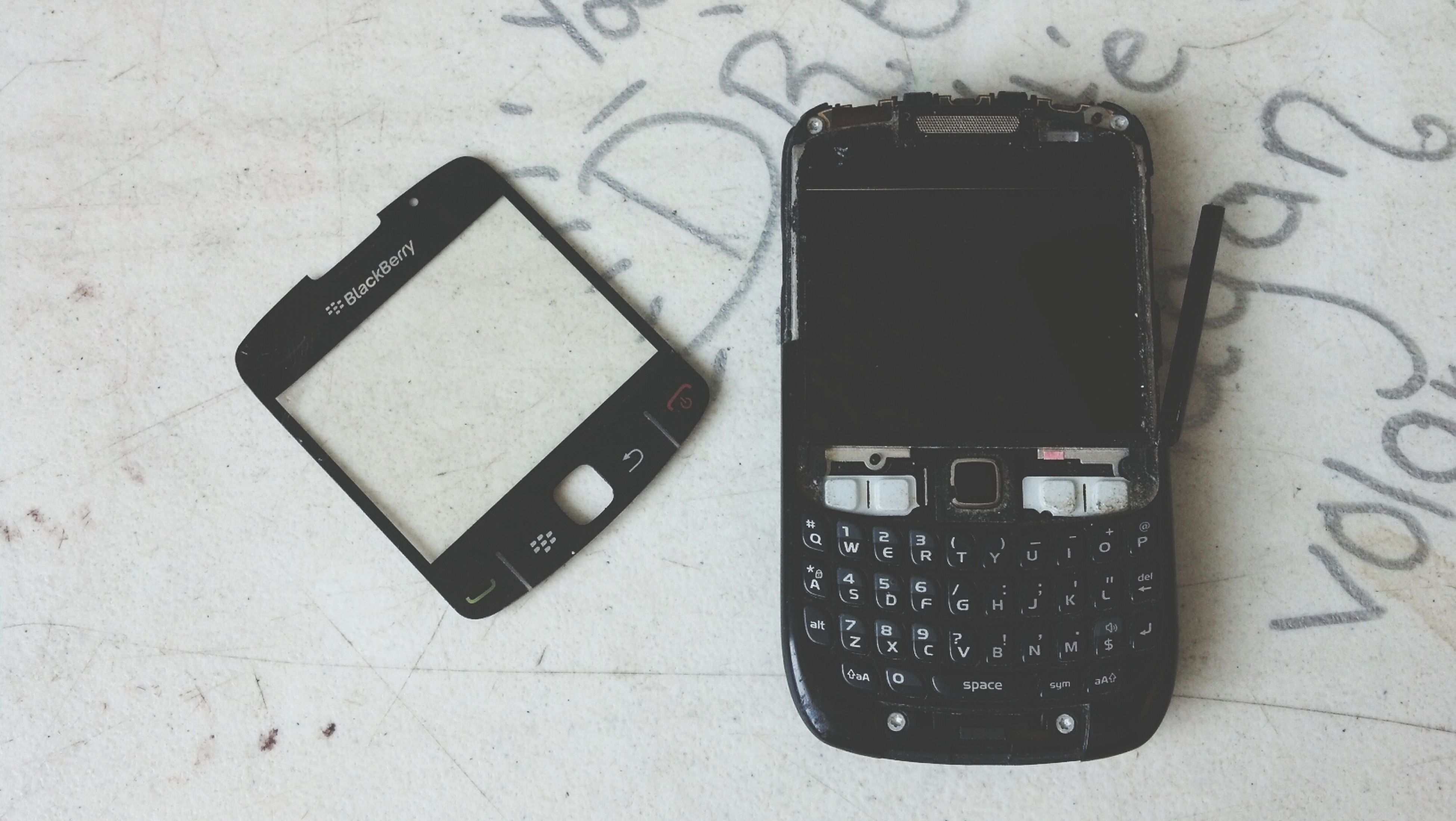 indoors, technology, communication, close-up, still life, high angle view, number, connection, table, text, retro styled, computer keyboard, wireless technology, no people, old-fashioned, black color, telephone, single object, equipment, metal