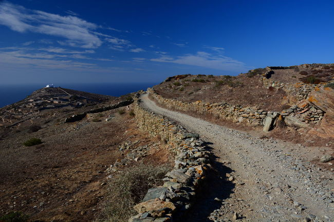 Folegandros island Aegean Sea Arid Climate Blue Cyclades Diminishing Perspective Dirt Road Eyeem Greece Folegandros Geology Greece Hellas Landscape Mediterranean  Non-urban Scene Outdoors Physical Geography Remote Road Scenics Sunny Tranquil Scene Travel Vanishing Point