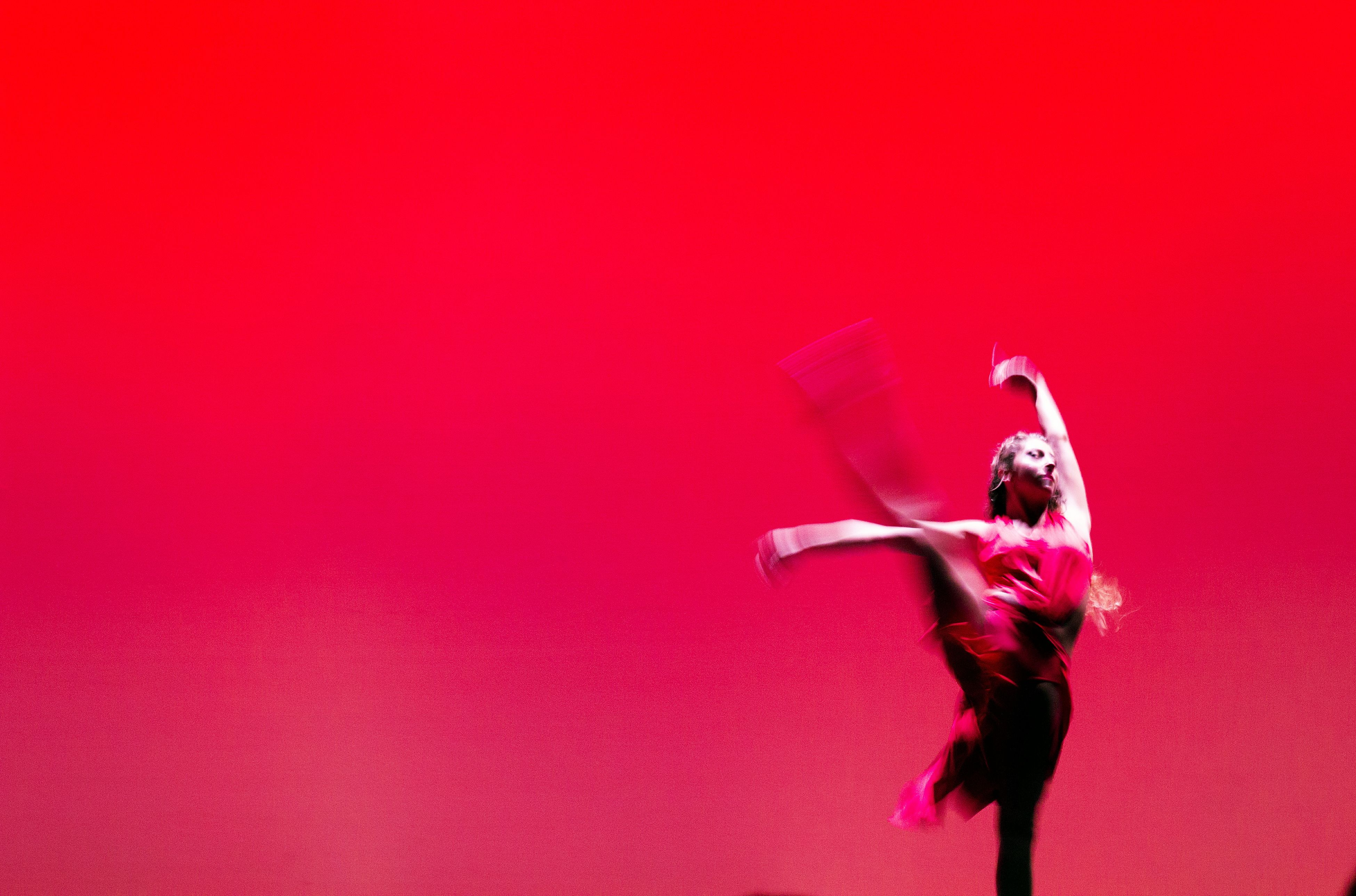 pink color, young adult, motion, one person, jumping, dancing, one young woman only, skill, performance, studio shot, young women, full length, one woman only, adult, adults only, day, people