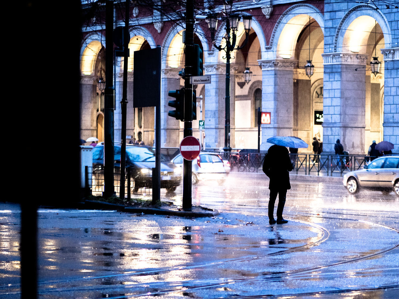 Raining in the streets Arch Architectural Column Architecture Building Exterior Built Structure City Cold Temperature Full Length Italy Men Night Outdoors People Raining Travel Destinations Turin Winter The City Light