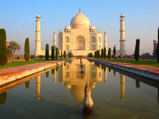 Taj Mahal at Sunrise Ancient Architecture Building Exterior Built Structure Clear Sky Cultures Dome Fountain History Mausoleum Mugalarchitecture Reflecting Pool Reflection Taj Mahal, Agra Tomb Tourism Travel Travel Destinations Water