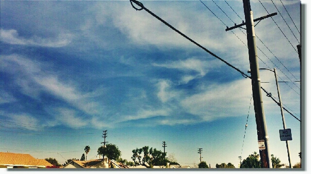 sky, cable, power line, cloud - sky, power supply, electricity pylon, electricity, day, connection, outdoors, fuel and power generation, no people, low angle view, telephone line, technology, tree, built structure, nature, architecture