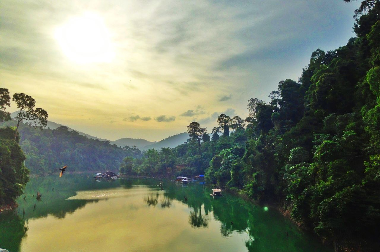 sky, scenics, mountain, beauty in nature, reflection, tranquil scene, water, nature, sunset, tranquility, lake, idyllic, tree, cloud - sky, waterfront, sun, outdoors, no people, mountain range, day