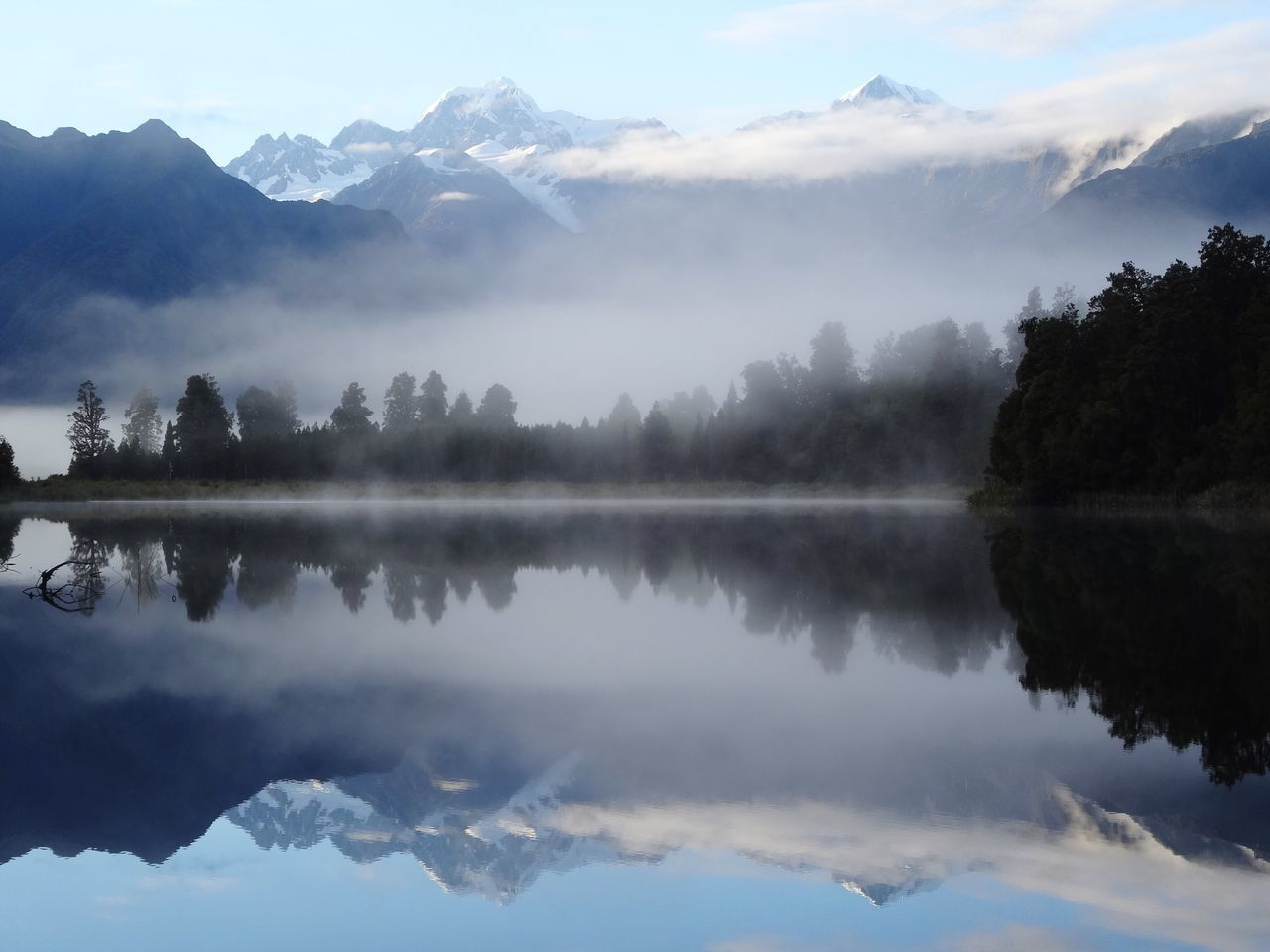 Reflection Mountain Water Nature Lake Tranquility Beauty In Nature Scenics No People Sky Mountain Range Fog Tranquil Scene Outdoors Day Tree Water Reflections Silence Symmetry Morning Light Lake Matheson Mirror Lake New Zealand Calm Foggy