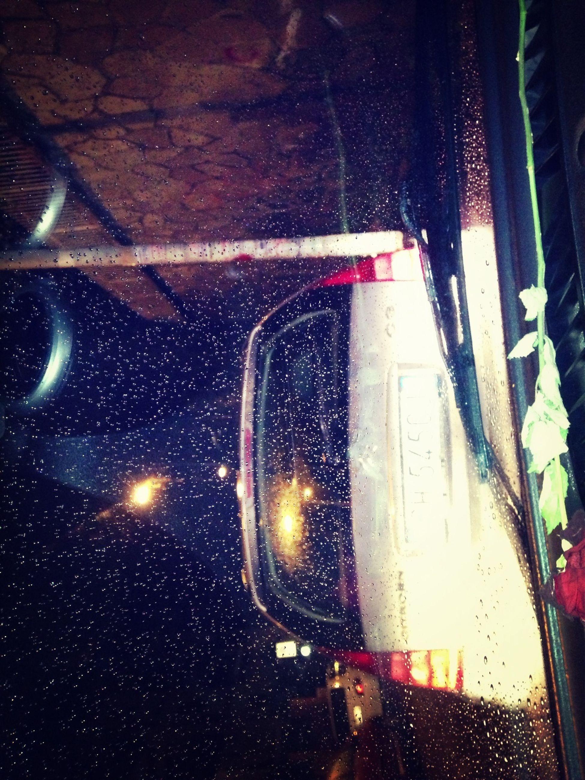 transportation, mode of transport, land vehicle, car, vehicle interior, glass - material, transparent, illuminated, indoors, window, train - vehicle, windshield, close-up, rail transportation, public transportation, headlight, wet, reflection, railroad track, travel