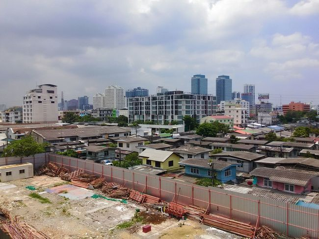 The Difference between Expensive Towers and Cheap Huoses at Ratchada, Bangkok, Thailand.
