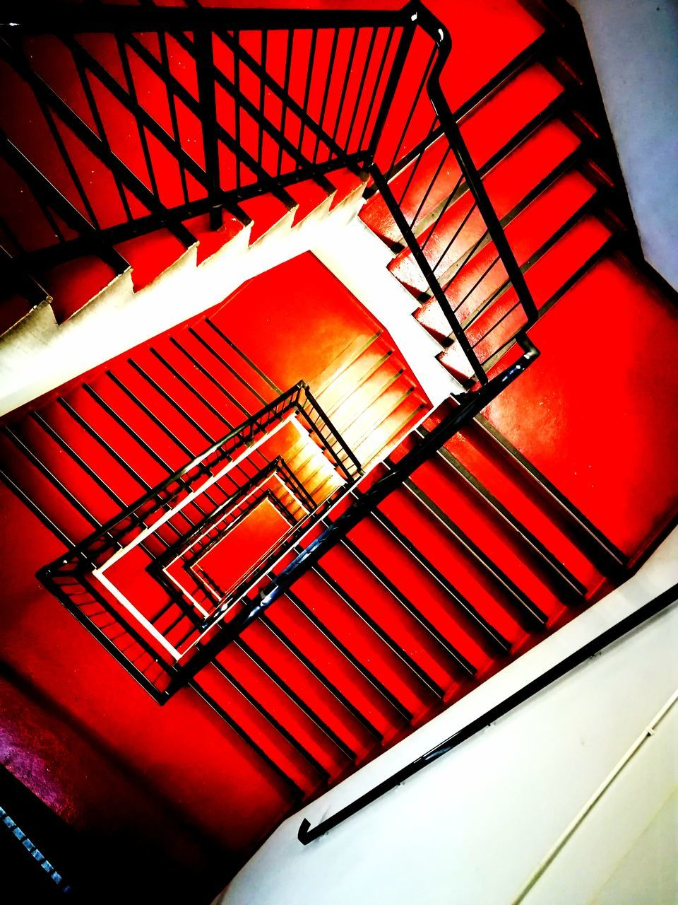 staircase, steps and staircases, steps, railing, stairs, spiral stairs, spiral, built structure, architecture, red, no people, low angle view, indoors, hand rail, day