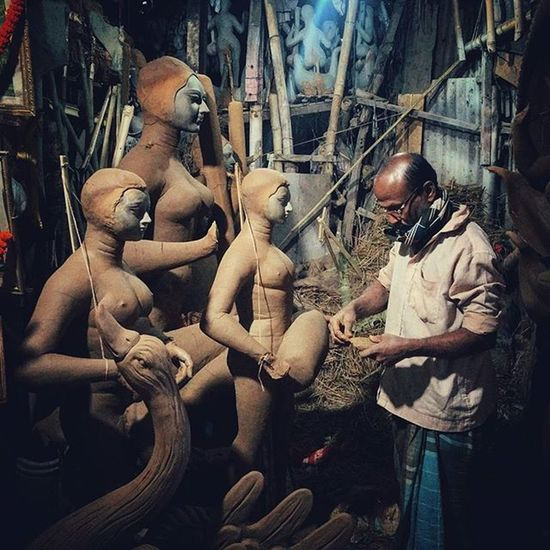 An Indian sculptor gives finishing touches to the clay statues of Hindu Gods and Goddesses at a workshop In Ranchi, Jharkhand, India. Once the clay structure is made, the statues are varnished. Hair made of jute is glued and the statue is then clothed, styled and ornamented as per the vedic customs. Everydayeverywhere Dailylife Photojournalism Journalism Reportage Reportagespotlight Cityofcities Hufgpostgram Indiaphotoproject Onepluslife Oneplus2 Myfeatureshoot Ranchi Jharkhand India ASIA