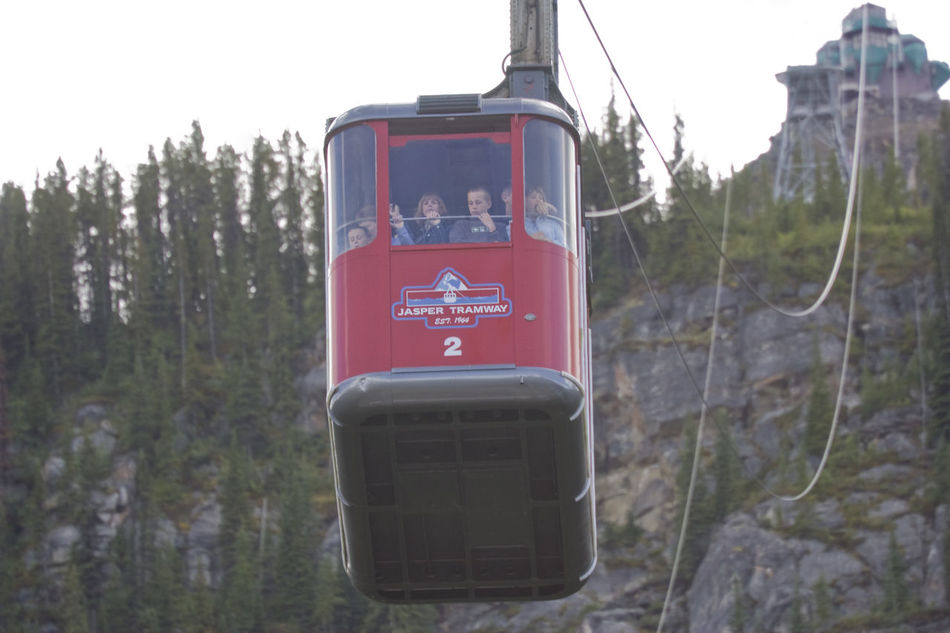 Jasper Tramway to Mount Whistler - red cable car in Jasper National Park, Alberta, Canada Alberta Cable Car Canadian Rockies  Childhood Close-up Convenience Gondola Jasper National Park Jasper Tramway Kids Mount Whistler Mountain Mountain Peak Passenger People Public Transportation Rocky Mountains Steep Text Tourism Tramway Transportation Travel Travel Destinations Vacations