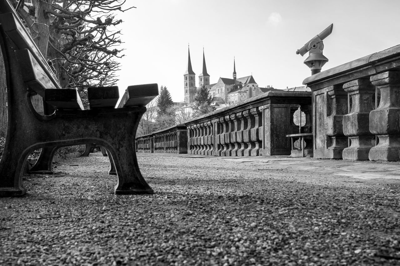 Rose Garden of the residence in Bamberg (and Michaelsberg abbey in the background) Architecture Bamberg  Bavaria Bayern Bench Building Exterior Built Structure Church Day Deterioration Deutschland EyeEm Black&white! Germany Incidental People Low Angle View Michaelsberg Abtei Neue Residenz Oberfranken Old Outdoors Place Of Worship Religion Rosengarten Ruined Shadow